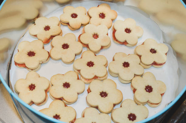christmas linzer biscuits stock photo