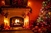 Christmas living room with fireplace and presents under tree