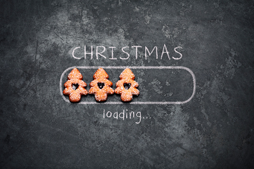 istock Christmas loading - Blackboard Holiday Decoration Red Baubles Humor 1059267396