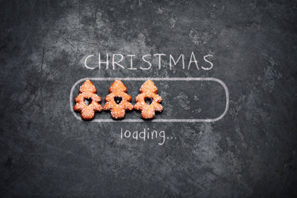 Christmas loading - Blackboard Holiday Decoration Red Baubles Humor stock photo