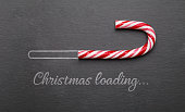 Christmas loading candy cane on blackboard