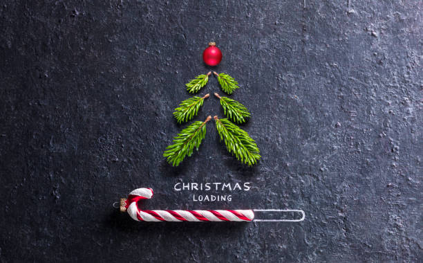 Christmas Loading Concept - Tree And Candy Canes On Black Stone Loading Concept With Candy Canes And - Tree And Christmas tree With Spruce Pine funny christmas stock pictures, royalty-free photos & images