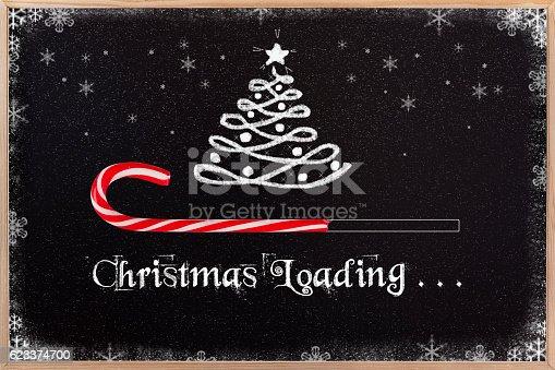 istock Christmas loading on blackboard. 623374700