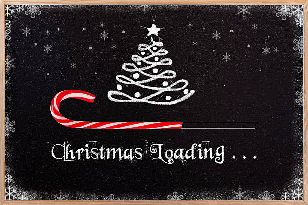 christmas loading on blackboard. - lustige grußkarten stock-fotos und bilder