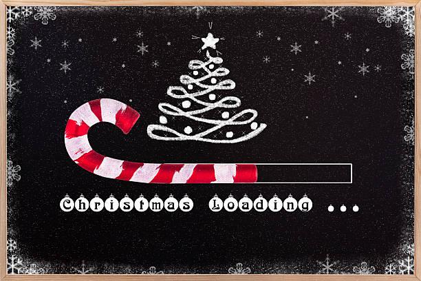 christmas loading on blackboard. - weihnachtsprogramm stock-fotos und bilder
