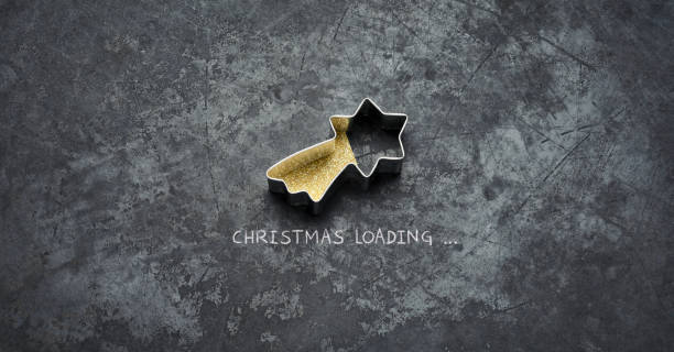 Christmas loading - Star Holiday Blackboard Metal Gold Glitter Fun Humor stock photo