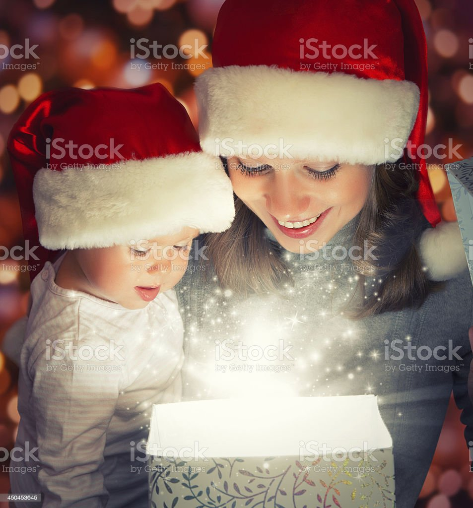 Christmas magic gift box and happy family mother baby royalty-free stock photo