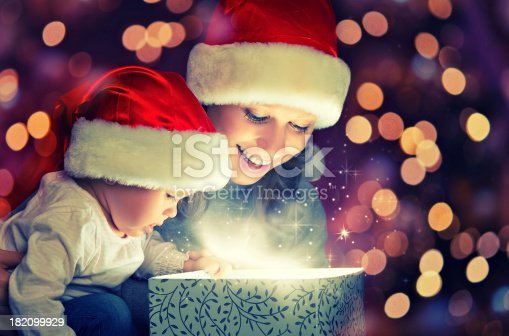 istock Christmas magic gift box, happy family mother and baby 182099929