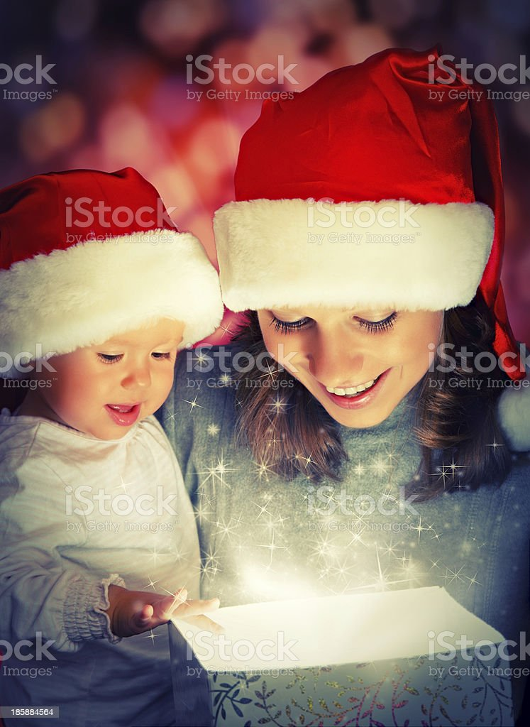 Christmas magic gift box, happy family mother and baby royalty-free stock photo