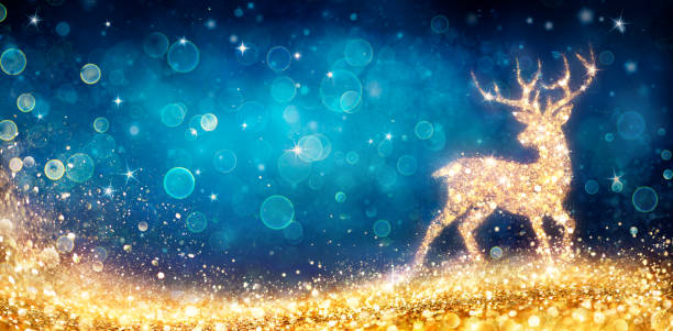 Christmas - Magic Golden Deer In Shiny Blue Background stock photo
