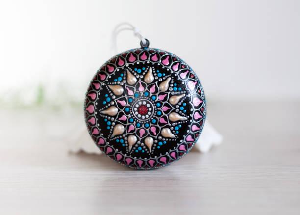 Christmas mandala ball on white background stock photo