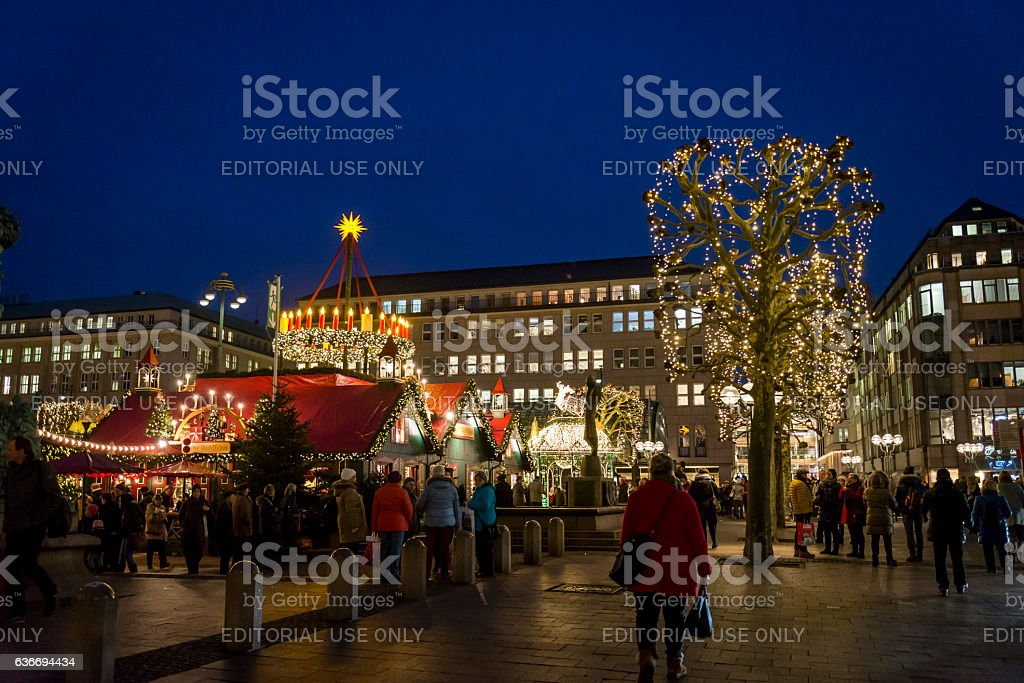 Stalls and people at Christmas Market at the central Town Hall Square...