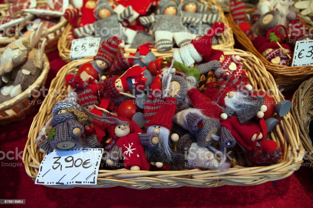 Christmas market basket full of little fellows wearing hats and...