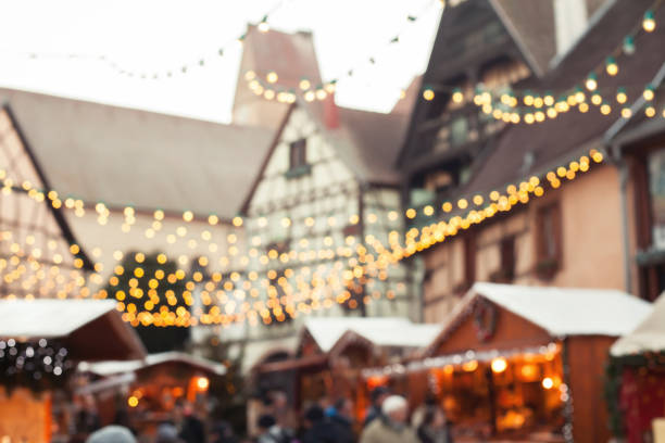 christmas market blurred background, decorated street in Europe stock photo