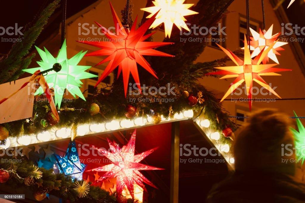 Christmas Market:  colourful christmas stars on stand stock photo