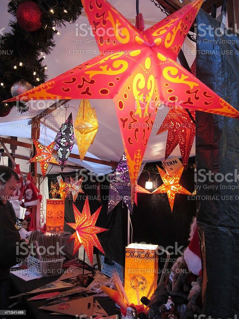 Christmas market in Berlin man wanna buy star lamp (Germany) stock photo