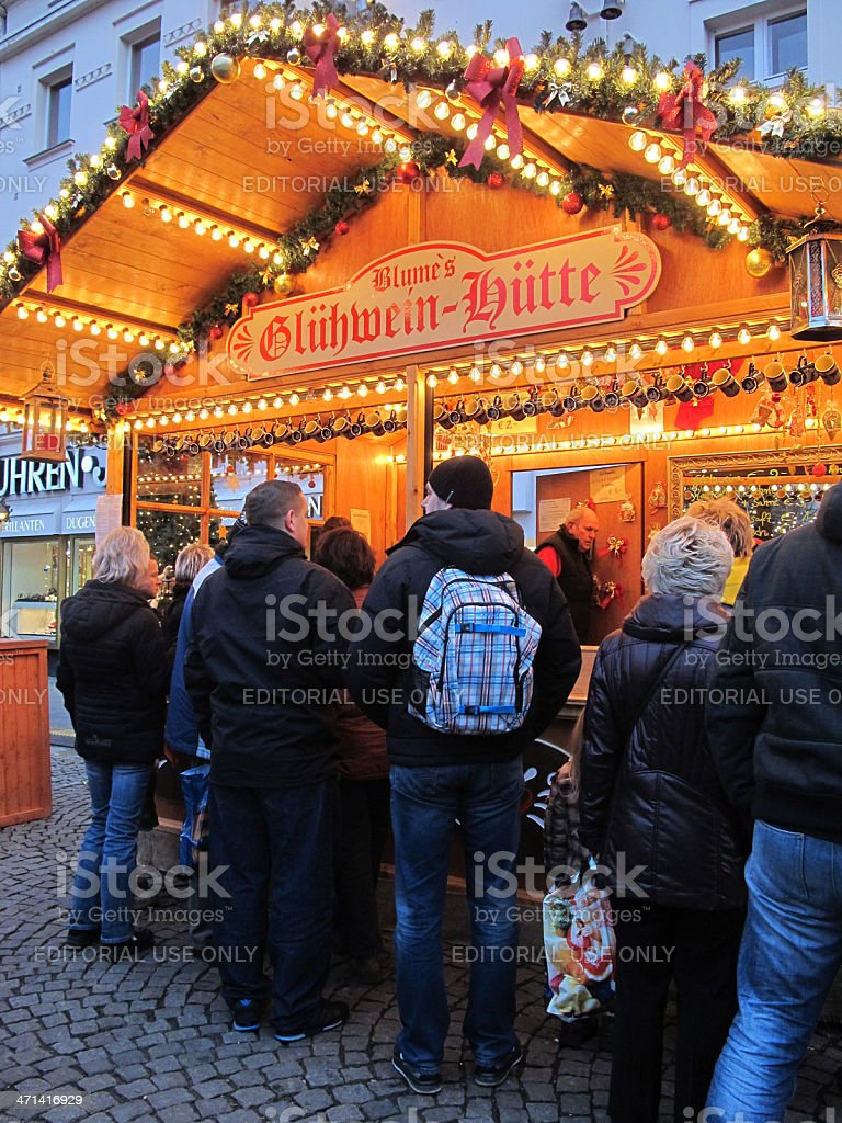 Christmas market in Berlin people wanna buy Mulled wine (Germany) stock photo