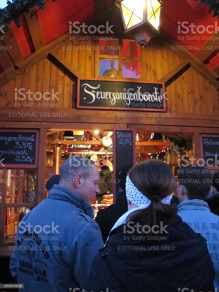 Christmas market in Berlin people wanna buy Mulled wine (Germany) royalty-free stock photo