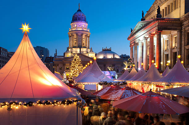 Christmas market in Berlin Christmas market at Gendarmenmarkt in Berlin Mitte. The German Cathedral (Deutscher Dom) in background and the Konzerthaus at the right side. gendarmenmarkt stock pictures, royalty-free photos & images