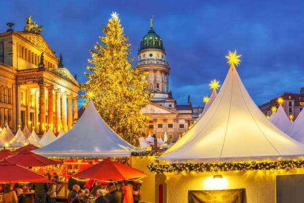 Christmas market in Berlin Christmas market, French church and konzerthaus in Berlin, Germany gendarmenmarkt stock pictures, royalty-free photos & images