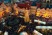 Prague: View from above on famous traditional Christmas market at Old Town Square illuminated and decorated for holidays in Prague - capital of Czech Republic.