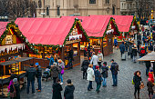 Prague, Czech Republic - December 11, 2015: Wooden stalls offering souvenirs and traditional food during Christmas market taking place each year on December in Old Town Square (aka Staromestske Namesti).
