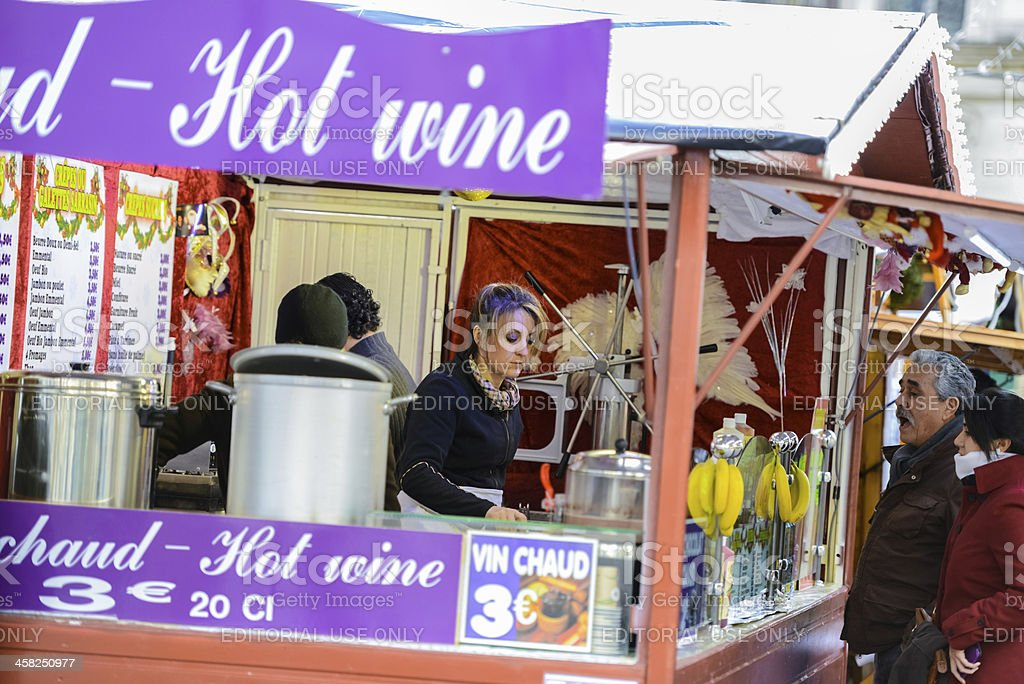 Christmas Market in Paris: People buying Hot Wine royalty-free stock photo