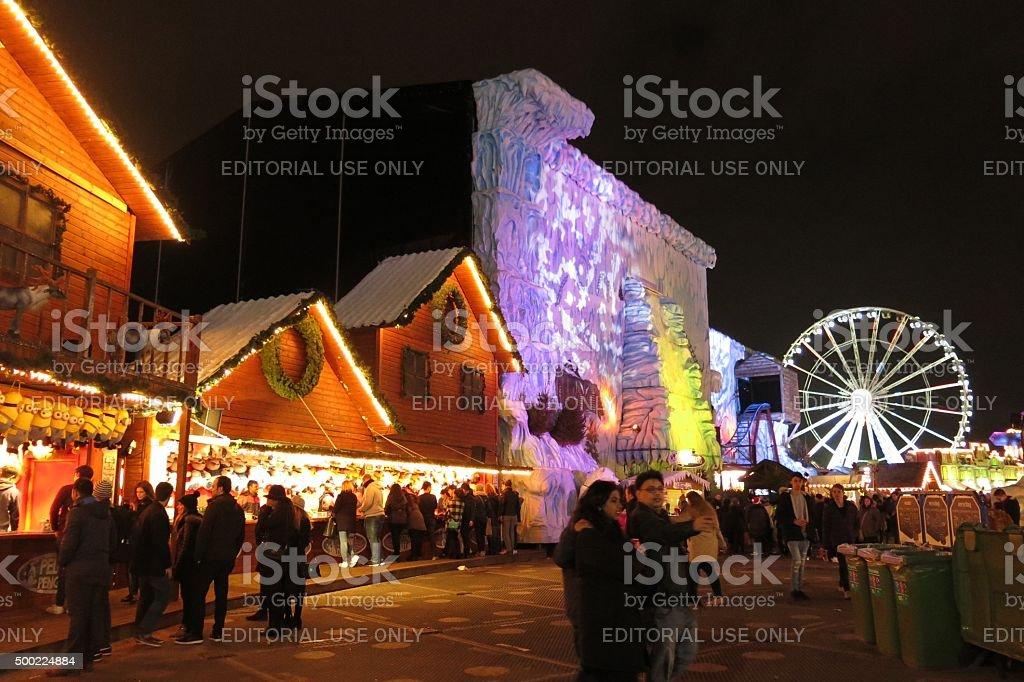 Christmas market London England Winter Wonderland ferris wheel and chalets stock photo