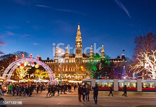 Christmas market on Rathausplatz in Vienna. (with Merry Christmas script in German)