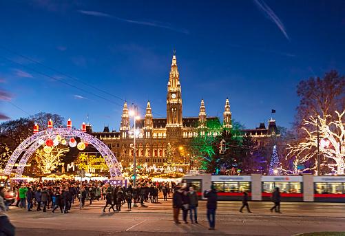 Christmas market on Rathausplatz in Vienna. (with Merry Christmas script in German)