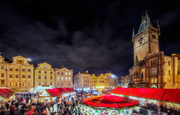 Christmas Market Prague Elevated panoramic view over Prags christmas market with the landmark townhall tower. astronomical clock prague stock pictures, royalty-free photos & images