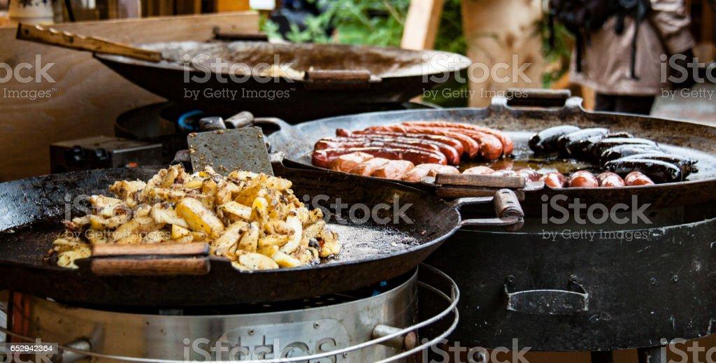 Christmas market: sausages and potatos stock photo