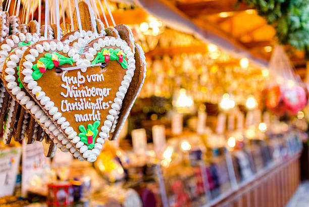 christmas market stall and gingerbread heart - german culture stock pictures, royalty-free photos & images
