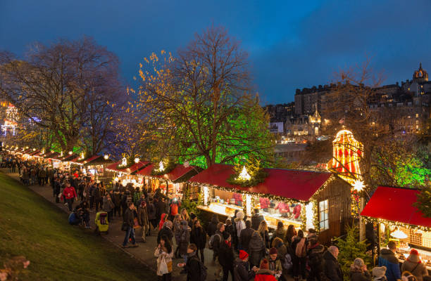 Christmas Market Stalls in Edinburgh Edinburgh, Scotland, UK - Crowds of shoppers and tourists browsing market stalls in Edinburgh's annual Winter Festival for Christmas and Hogmanay (New Year) in the city centre. princes street edinburgh stock pictures, royalty-free photos & images