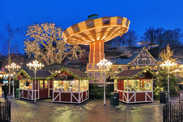 Christmas Market with Carousel in the Liseberg amusement park in Gothenburg, Sweden stock photo