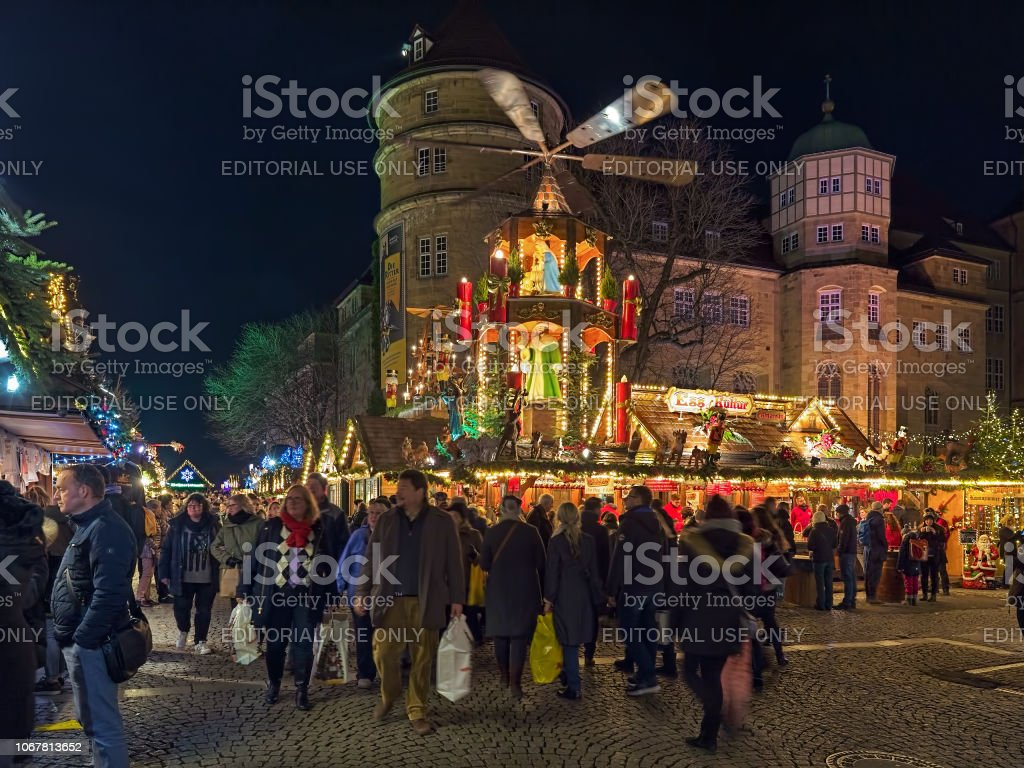 Christmas In Stuttgart Germany.Christmas Market With Christmas Pyramid Close To Old Castle
