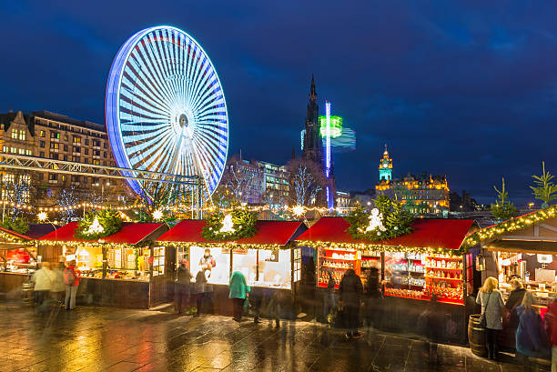 Christmas Markets, Edinburgh, Scotland Wide angle view of the Christmas Markets in Princes Street Gardens in Edinburgh, Scotland, UK. princes street edinburgh stock pictures, royalty-free photos & images