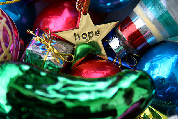 Christmas Means Hope: Background of Holiday Decorations Ornaments stock photo
