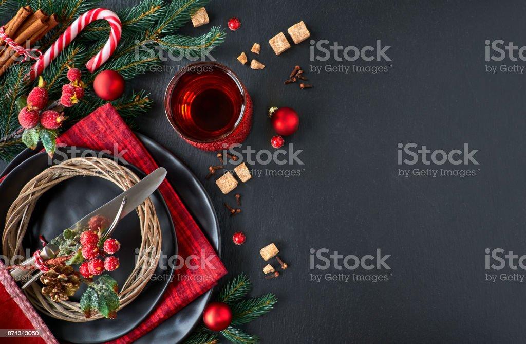 Christmas menu concept on dark stone slate, text space stock photo