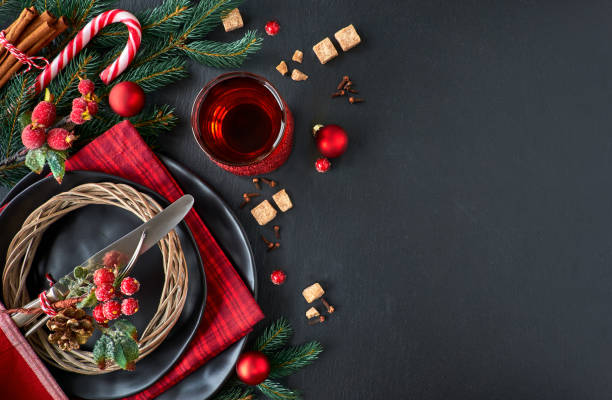 Christmas menu concept on dark stone slate, text space stock photo