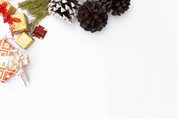 Christmas mockup composition. Christmas gift, pine cones, fir branches on wooden white background. top view, copy space stock photo