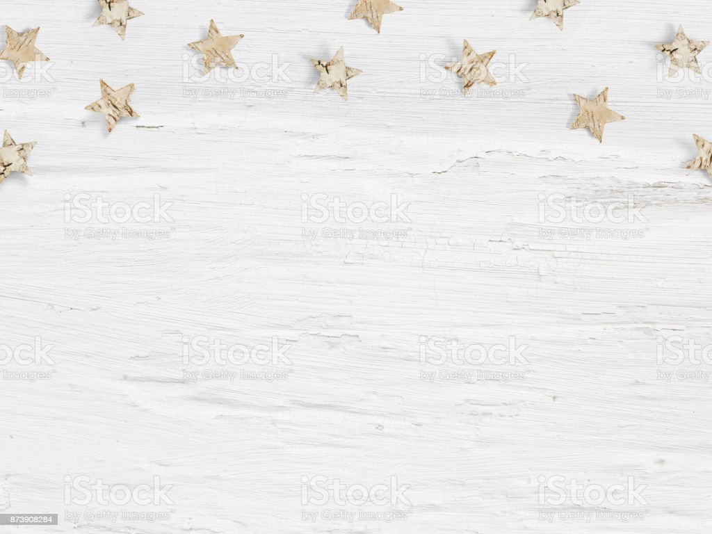 Christmas mockup scene little wooden stars made of birch bark on white grunge background. Empty space for your text, top view flat lay photography stock photo