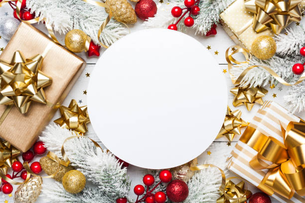 christmas mockup with gift or present boxes, snowy fir tree and holiday decorations on white wooden table top view. - regalo natale foto e immagini stock