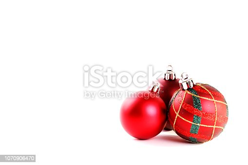 Minimalistic festive composition with colorful matte christmas balls. Fancy beautiful decoration for christmas pine tree. Background, copy space, close up, front view.