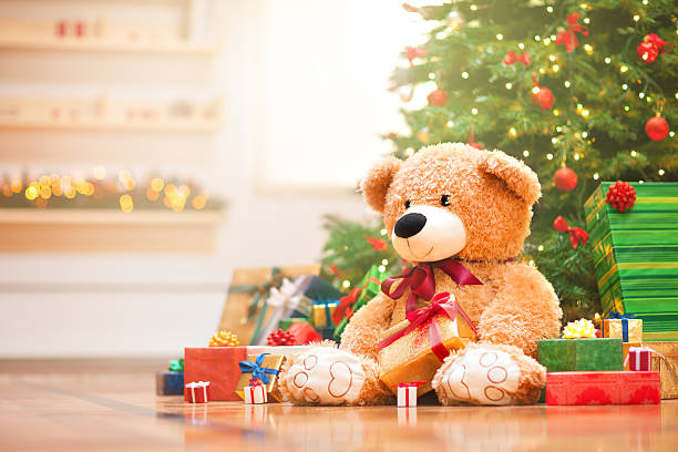 Christmas morning Christmas gifts under christmas tree in the sunny morning. christmas teddy bear stock pictures, royalty-free photos & images