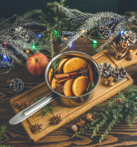 Christmas mulled red wine with the addition of spices and citrus fruits stock photo