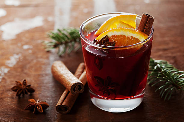christmas mulled wine or gluhwein with cinnamon and anise star - mulled wine stock photos and pictures
