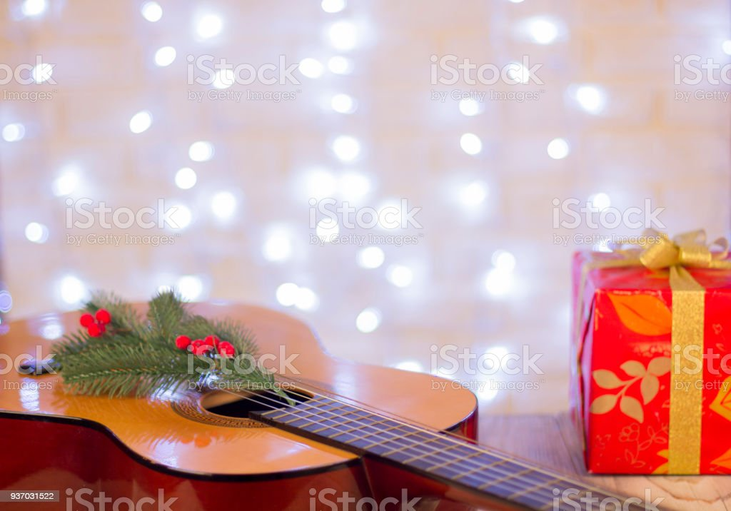 Christmas Music Background With Guitar And Red Gift Stock Photo - Download Image Now - iStock