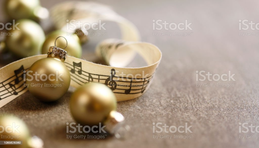 Christmas baubles and ribbon with music notes.
