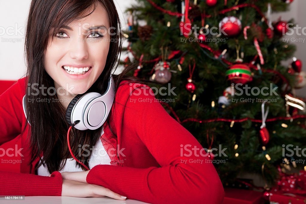 Teenager with headphone in living room